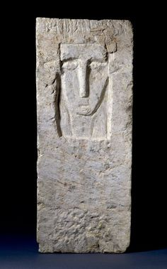 Rectangular, white limestone stela with a face carved in low relief within a coarsely, chiselled rectangular recess on one side and a line of South Arabian (Sabaean) inscription above human face, along top edge of same side; degraded chequer pattern in dull red brown paint over the flat face of the stela below the portrait.  Ancient South Arabian The British Museum | Rectangular, white limestone stela with a face carved in low relief within a coarsely, chiselled rectangular recess.