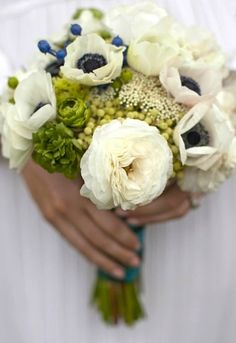 White and green bouquet with small blue accents