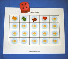 fish game. Child rolls the die and places one goldfish on a fish bowl for each corresponding dot on the die. For example, if the child rolls a 4 then he or she would place 4 fish on their mat. This activity promotes one-to-correspondence.