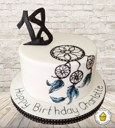 Dreamcatcher inspired 18th birthday cake. A simple white cake, handpainted with a freehand Dream catcher design.