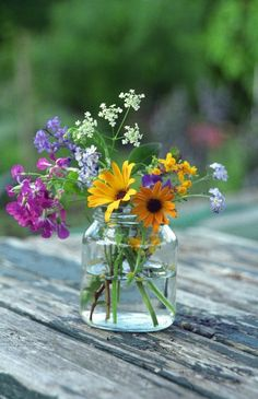 wild flowers in a glass jar vase