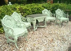 SET OF FOUR SEASONS GARDEN FURNITURE, CAST IRON