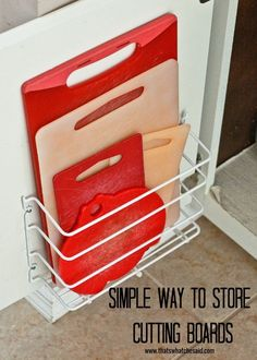 The perfect cutting board storage for small and big kitchens!  Keep them right at your fingertips and out of site and it only cost $2 in supplies from the dollar store!