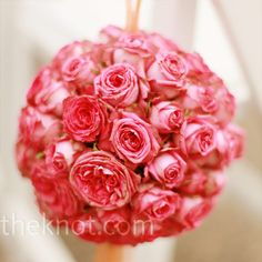 Decorate some of your ceremony chairs with big, bright pomanders of garden roses.