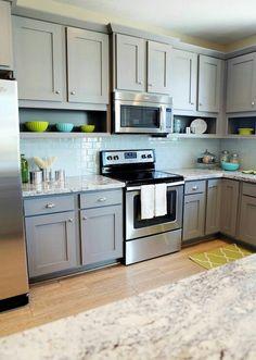 Grey cabinets and teal subway tile backsplash <3