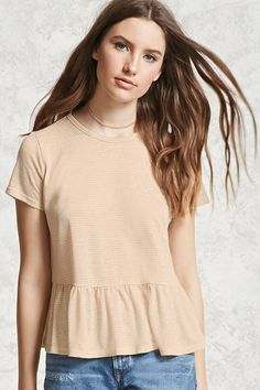 A slub knit top featuring a crew neck, short sleeves, and a peplum hem.