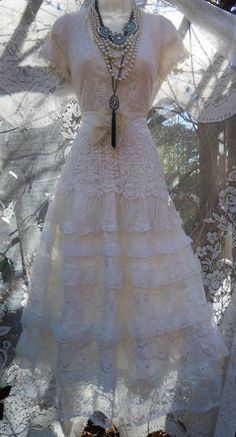 Lace wedding dress handmade by vintage opulence on Etsy  The top is a soft white lace with lining , cap sleeves a round neckline and a lace sash
