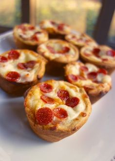Deep Dish Pizza Cupcakes - refrigerated crescent rolls, pizza sauce, mozzarella and your favorite toppings baked in a muffin pan. Great for a quick lunch or dinner or football party. Ready in under 20 minutes!
