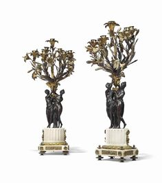 A PAIR OF FRENCH ORMOLU, PATINATED-BRONZE AND WHITE MARBLE SEVEN-LIGHT CANDELABRA  SECOND HALF 19TH CENTURY, IN THE MANNER OF ETIENNE-MAURICE FALCONET, AFTER THE DESIGN BY GABRIEL DE SAINT-AUBIN