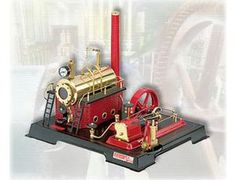 """The Wilesco D21 Steam Engine with Pump has a mirror polished brass boiler, with a diameter of 2.6"""", length 6.5"""", boiler capacity 30.5 in"""", with water gauge glass, water drain cock. Boiler house true to life, colored, with embossed brick type walls, 2 footbridges with railing and 2 ladders. Double action reversible brass cylinder with flywheel, spring loaded safety valve, additional steam whistle with chain, pressure gauge, steam regulator and flywheel of 3.9"""" diameter with grooved pulley."""