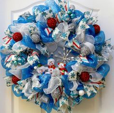 Do you want to build a snowman? This winter snowman deco mesh wreath will add a festive touch to your Christmas or winter decor this season! This