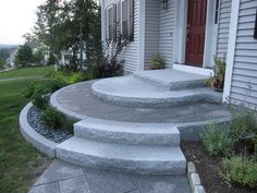 Curved granite entrance with inlaid stone (Refacing Cement Step)