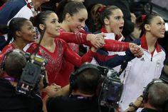 Gabrielle Douglas, Alexandra Raisman, Jordyn Wieber, McKayla Maroney and Kyla Ross react as they watch the screen that displays results declaring them winners of the gold medal during the women's team final Team Usa Gymnastics, Gymnastics Posters, Olympic Gymnastics, Cheerleading, Olympic Badminton, Olympic Games Sports, Olympic Team, 2012 Summer Olympics, Olympics News