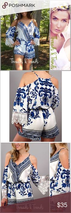 """Indigo Porcelain Floral Printed Romper Gorgeous colors of white and indigo blue cold shoulder romper. Crochet lace detail cuffs on sleeves, printed pattern. Deep V neckline with hidden snap closure. No worries non sheer and fully lined shorts. Very nice quality medium weight poly/rayon blend flowy fabric. Size S, M, L           Small Bust 36"""" Elastic waist 24"""" Hips 36"""" Length 29"""" Medium Bust 40"""" Elastic Waist 26"""" Hips 40"""" Length 31"""" Large Bust  42"""" Elastic waist 28"""" Hips 42"""" Length 31""""…"""
