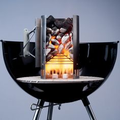 Close up of Genuine Weber charcoal chimney starter will guarantee easy barbecue starting every time.