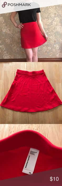 ✨FINAL DROP✨American Apparel Red Skater Skirt Red skater skirt. A-line but is quite tight as shown in pic. I am 5ft so it will be a mini skirt on taller figures. True to size. Perfect for the holidays! Comment with questions ♥️ American Apparel Skirts Mini