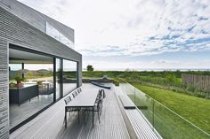 Built for a family, who are the third generation owners of VIPP this beach villa, Dragor House, is designed by Studio David Thulstrup and Mads Lund. Farnsworth House, New Home Quotes, Balcony Planters, Outdoor Living Rooms, Outdoor Spaces, Studios Architecture, Best Home Gym, Beach Villa, Natural Scenery