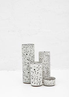 Medium glazed ceramic tube vase with volcanic texture detailing. Stoneware; sand volcanic glaze. Josh Herman \ Totokaelo