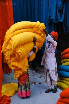 "India        THEY LOVE COLOR……""HERE, MY DEAR WIFE, LET ME TAKE UP MY PRECIOUS TIME TO ADJUST THIS LOAD FOR YOU---O.K. OFF YOU GO  -  HURRY BACK FOR ANOTHER LOAD''………ccp"