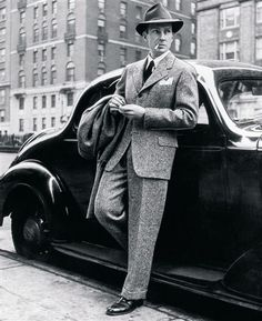 """""""By the early thirties, the """"London Drape"""" suit was taking the world of men's fashion by storm. Jacket had light padding to the shoulders and a slightly nipped in waist. The wide, straight leg trousers that men had worn in the 1920s and early 1930's also became tapered at the bottom for the first time around 1935. This new suit was accepted enthusiastically by the big iconic Hollywood stars of the time. The typical hat of this period was the Fedora hat."""" ― www.tweedmansvintage.co.uk"""