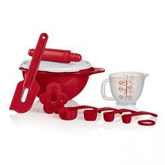 Tupperware Kids Mini Baking Set:          Share the great joy of baking and passing down family recipes with your young ones. Includes 6-cup/1.4 L Thatsa® Mini Bowl*, Spatula, Mini Mix-N-Pour Pitcher, Mini Rolling Pin, Mini Cookie Cutter and Sifter.  Artwork on Mini Mix-N-Pour Pitcher not covered by Limited Lifetime Warranty.     Item:10128474000