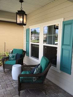 The Boca II Model in The Palms at Nocatee has a peaceful relaxing front porch with a pop of color. #nocatee
