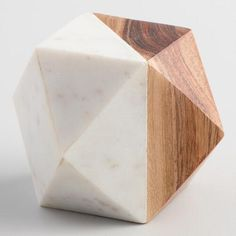 Half wood, half marble, our faceted, mixed-media paperweight adds an abstract, geometric vibe to your desk. Its natural finish and solid construction exude a museum-quality feel.