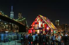 Brooklyn-based artist Tom Fruin installed his beautiful stained plexiglass house, Kolonihavehus, at Brooklyn Bridge Park as part of this year's DUMBO Arts Festival.