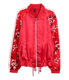 Red. Bomber jacket in satin. Zip at front, patterned sleeves with contrasting sections, welt side pockets, and drawstring at hem. Ribbing at neckline and