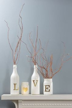 Vinyl Lettering as a stencil makes this unique glass bottle décor easy! Reuse wine bottles and mason jars for great mantle of table decorations!