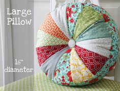Cute Pillow!  Wouldn't this be nice from the materials leftover from a quilt project? This site has an easy tutorial for this pillow in two sizes.