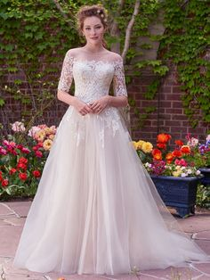 Classic, sophisticated, beautiful and so elegant. We love the long lace sleeves on the Yvonne wedding dress by Rebecca Ingram by @maggiesottero collection. #rebeccaingram #rebeccabride