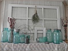 "Vintage Jars & Old window: ""I have been collecting Vintage #MasonJars for a while now and am completely in love with them. First because they are simply beautiful and every time I  touch one I wonder what it has seen? Where did it live? Did someone can something wonderful in it? Did it sit on a shelf staring out the window at a nearby garden wondering what would come next year?"""