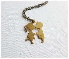 Kissing Couple Necklace by Aqsa http://www.etsy.com/listing/89111295/kissing-couple-necklace