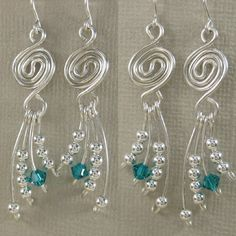 Etsy earrings: swirly wire with dangling wire wrapped beads.