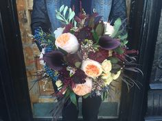Wedding bouquet featuring juliet garden roses, calla lilies, agonis foliage, and other seasonal floral.