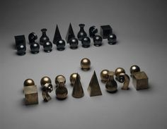 Man Ray  American, 1890–1976    Chess Set, 1927    Brass, silver, and gold  22 3/4 x 16 x 2 1/2 in. overall dimensions