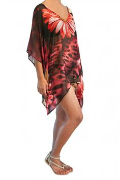 (http://www.notinthemalls.com/products/Kaftan-–-Garden-of-the-Jungle-Cat-%2d-Berry-Red.html)