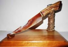 Amazing Piranha Agate knife on a hand carved cedar handle capped with recon Tigereye gemstone. Beautiful Piranha Agate blade knapped and signed by Mike Cook. I made a cedar handle that is so beautiful and I capped it with recon Tigereye gemstone. It is also wrapped with genuine deer leg sinew.