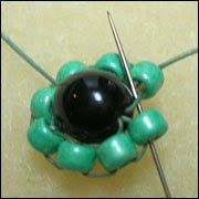The Practical Beader: Circular Brick Stitch around a bead - used as a base for more rows.  #Seed #Bead #Tutorials