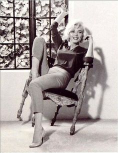 Marilyn - smiling in a chair.