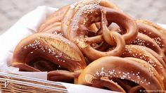Brezel (soft pretzel) // 11 bakery bestsellers in Germany  A man in lederhosen drinks a beer at a blue-and-white checked table. A soft pretzel - sliced horizontally and slathered with butter - will inevitably lie next to the beer in any stereotypical image of Bavaria. The southern specialty, known in the south as Brez'n and elswhere as Brezel, can be found across Germany. Many bakeries take typical pretzel dough and roll it into sticks or rounds instead.