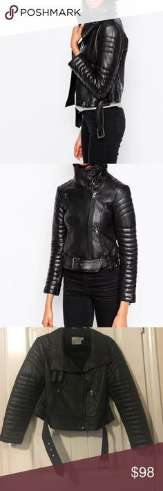 ASOS Leather Biker Jacket Genuine Leather Biker Jacket from ASOS. Has a funnel neck with 2 buckle closures, side zip up, buckled waist.  Has 3 functional zippered pockets on the front and zipper detailing on sleeves ASOS Jackets & Coats