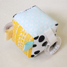 Interactive baby soft block, handmade in Byron Bay by Babee and Me. Aqua, yellow, black geometric.