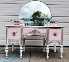 Antique vanity refinished in general finishes little pink and snow white and glazed.