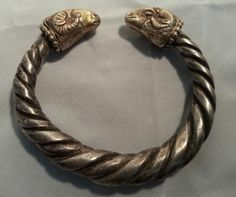 Massive Greek or Early Roman  Silver Bracelet ,  bracelet decorated on both ends with detailed  and gilded  heads of rams, ca 2nd c.BC-1st c. AD