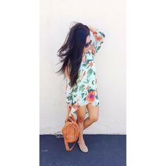 Jessica wearing our Split Sleeve Trapeze Floral Dress