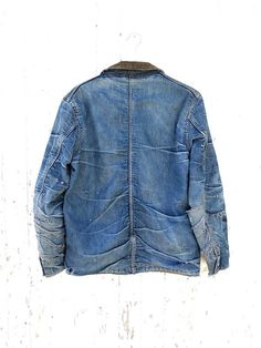 Vintage blanket lined denim chore jacket from the 1940s. Amazing indigo denim with the most awesome honeycomb fades Ive ever come across. Unbranded. Denim is beautifully worn in and soft. Multiple repairs, patches, and a few tears. Wool lining is intact with one largish hole near shoulder, and one or two smaller holes. Measurements Shoulder to shoulder 18 Pit to pit 21 Sleeve 24 Length 30