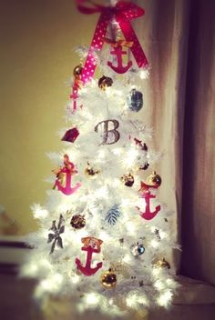 Small white and pink nautical Christmas tree with anchor ornaments: http://www.completely-coastal.com/2013/11/white-Christmas-trees-beach-coastal.html Girly cute!