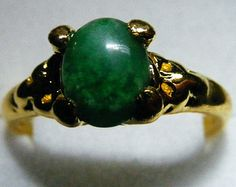 14K gold with green gemstone Size 7